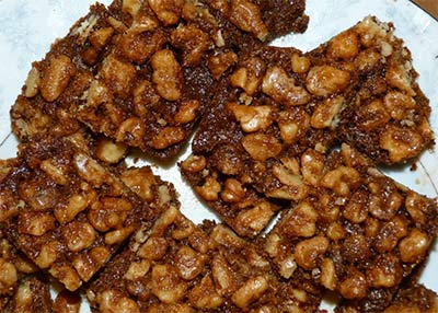 Close up of maple walnut squares on plate.