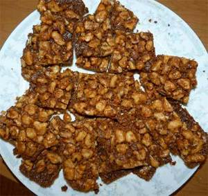 Maple walunt squares sliced up and placed on plate.