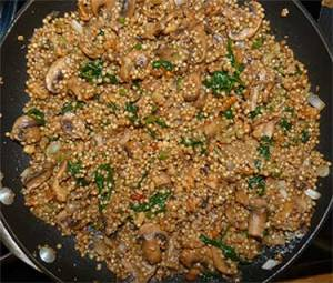 Finished sorghum and mushroom pilaf in skillet