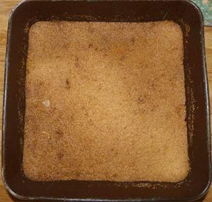 Bottom layer of squares in pan after baking.