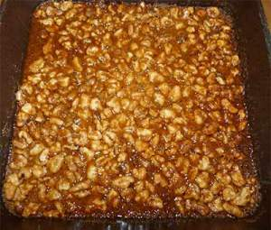 Maple Walnut Squares in pan fresh out of oven and bubbly