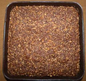Finished applesauce crumb cake in pan fresh out of the oven.