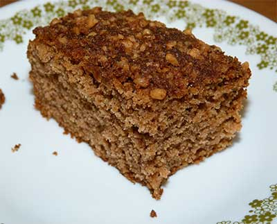 Slice of applesauce crumb cake on plate
