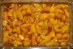 Peaches in cassarole dish, ready to add dough.