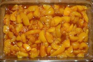 Peaches in cassarole dish, ready to add dough.