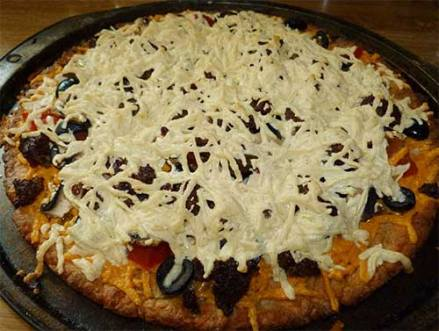 Cooked pizza with Daiy cheese.