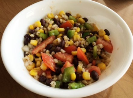 A serving of whole grain sorghum salad in a small white bowl.