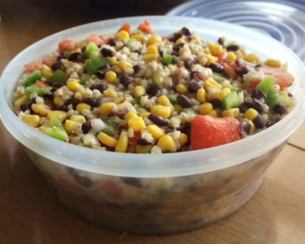 Whole grain sorghum salad filling up a 2-quart Tupperware container.