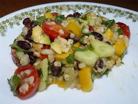 Finished sorghum salad with lime dressing on a plate ready to eat.