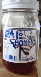 Close up of jar of Tule Creek Honey from Tulia, Texas.