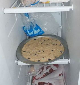 Blueberry scone batter in pie pan on shelf in the freezer.