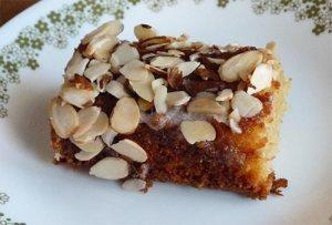 Piece of lemon almond cake on dessert plate.