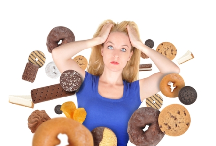 Frustrated woman with gluten-containing foods