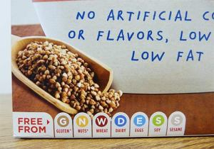 Close up of the bottom of the Ancient Grain Flakes box showing FREE FROM and seven icons for various allergens, gluten being the first.