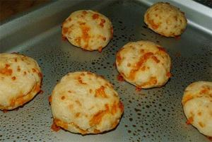 Close up of cooked gluten free cheese biscuits on baking sheet.