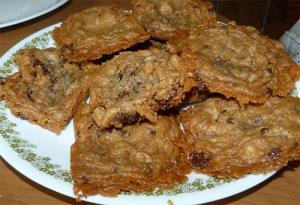Gluten-free chocolate chip cookies piled up on a plate.