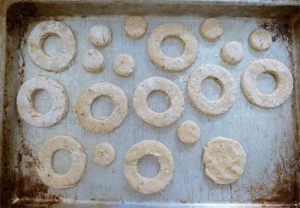 More dog snacks on a tray - some are shaped like doughnuts and some are like doughnut holes.