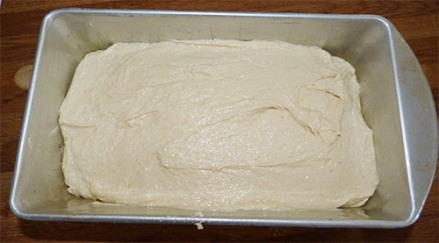 Gluten-free pound cake batter smoothed out in loaf pan.