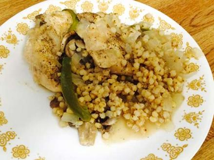 Plate with whole grain sorghum and chicken casserole on it.