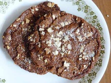 Two gluten-free ginger cookies on a dessert plate.