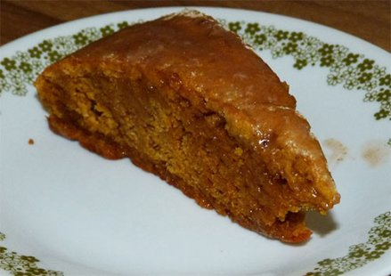 Gluten-free pumpkin scone on plate, ready to eat.