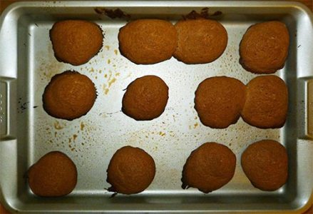 Baked cookies on cookie sheet.