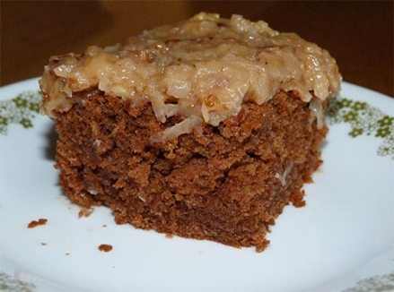 Piece of German Chocolate cake on plate.
