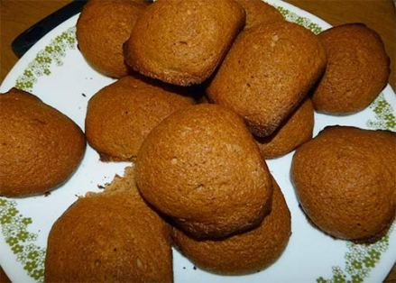 A pile of cinnamon maple cookies on a plate.