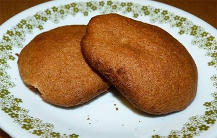 Two gluten-free cinnamon maple cookies on a dessert plate