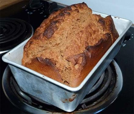Baked loaf of gluten-free molasses quick bread.