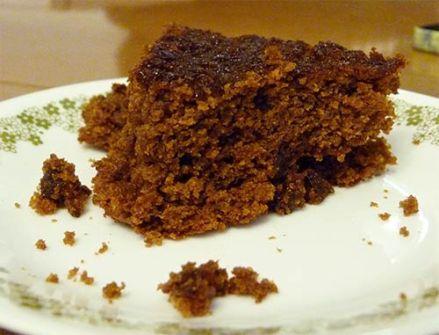 Gluten-free ginger cake slice on dessert plate.
