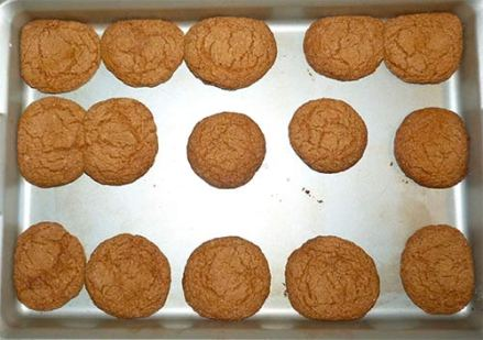 Baked gluten-free ginger cookies on baking tray.