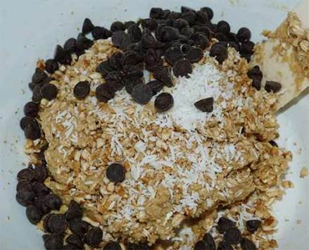 Gluten-free oatmeal cookie dough with chocolate chips, coconut and pecans poured on top.