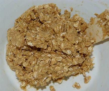 Gluten-free oatmeal cookie dough in white mixing bowl.