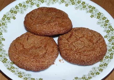 Three ginger cookies on a dessert plate.