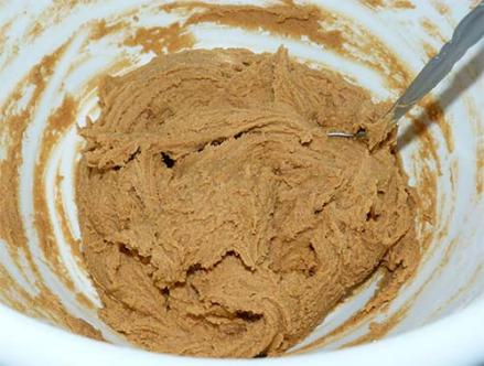 Gluten-free ginger cookie dough mixed up in a white mixing bowl.