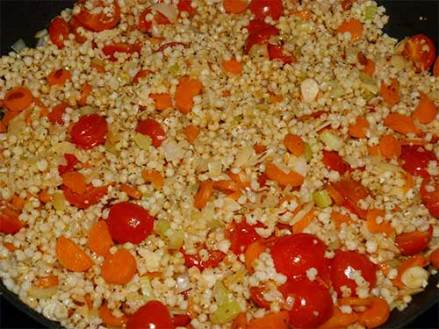 Sorghum pilaf in frying pan.