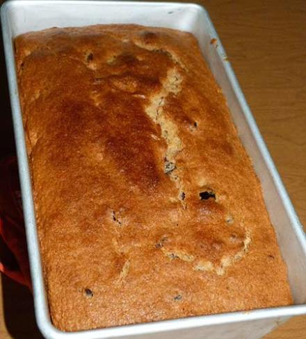 Baked gluten-free orange cranberry bread in loaf pan.