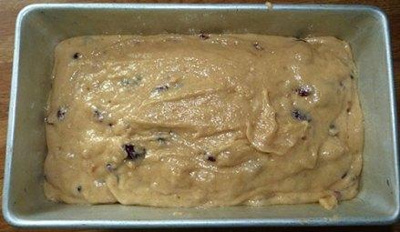 Gluten-free orange cranberry bread batter in loaf pan.