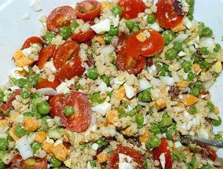 Pea salad mixture with tomatoes added.