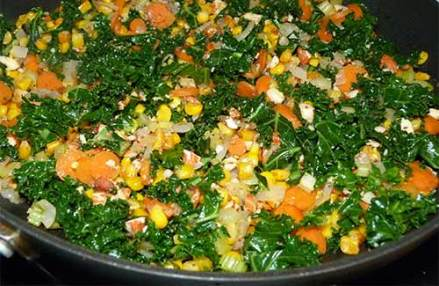 Vegetables and almonds mixed together in skillet.