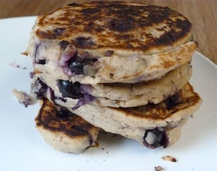 Stack of gluten free blueberry pancakes on a white plate.