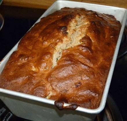 Freshly baked banana zucchini bread still in the baking pan.