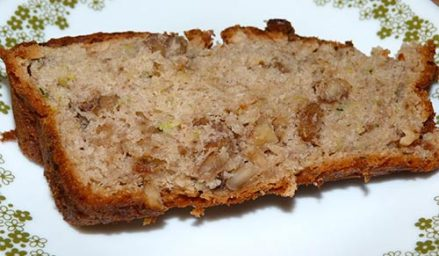 Sice of gluten-free banana zucchini bread on a dessert plate.