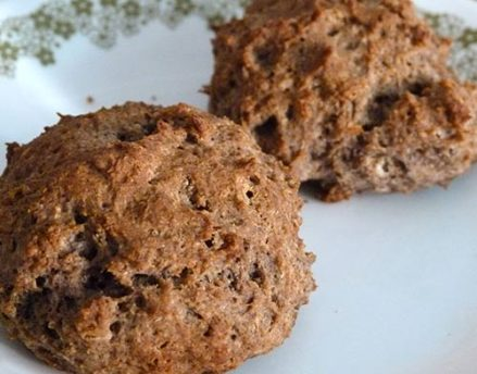 Close up of two buckwheat sorghum biscuits.