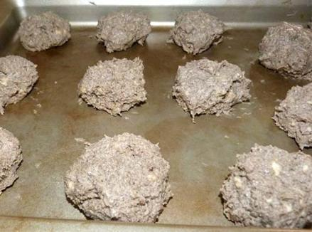 Buckwheat sorghum dough formed into balls on baking sheet.